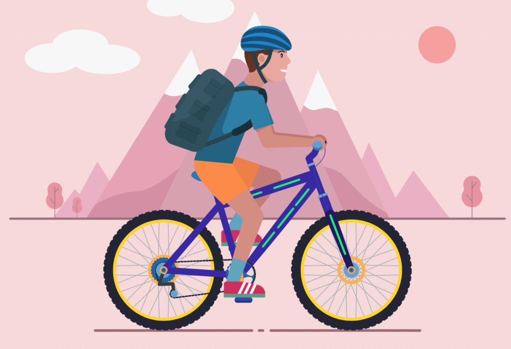 Persona montando una bicicleta y usando un casco protector